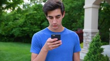young man messaging on his phone