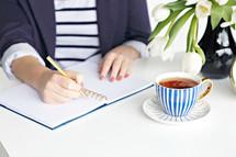 a woman journaling
