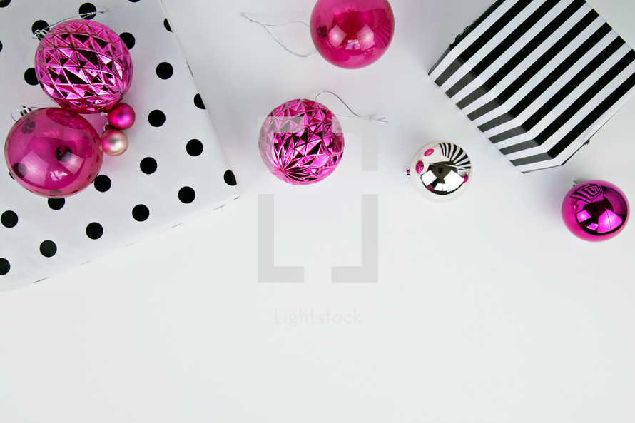 pink ornaments and black and white wrapping paper