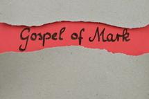 Gospel of Mark - torn open kraft paper over light red paper with the name of the Gospel of Mark