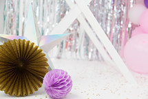 star, gold, and purple paper party decorations