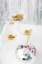 star confetti and disco ball drink with straw
