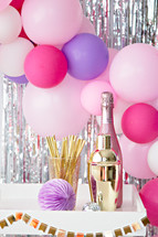 balloon arch and champagne
