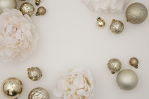 gold ornaments and light pink flowers
