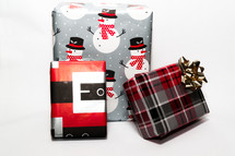 wrapped Christmas gifts on a white background