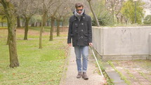 blind man walking in a park