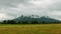 a mountain peak in the clouds