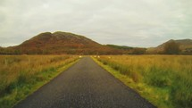 driving down a rural road in Scotland