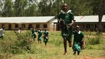 Children running from school in Kenya