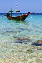 boat in Tao Bay and South China sea