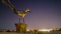 roadrunner statue at night