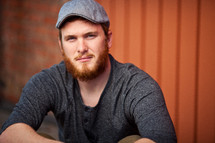A man wearing a hat that has a red beard