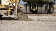 a tractor grading soil