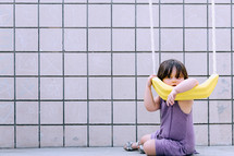 a girl child hanging on a swing