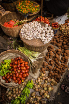 vegetables, nuts, and spices in a market in Haiti
