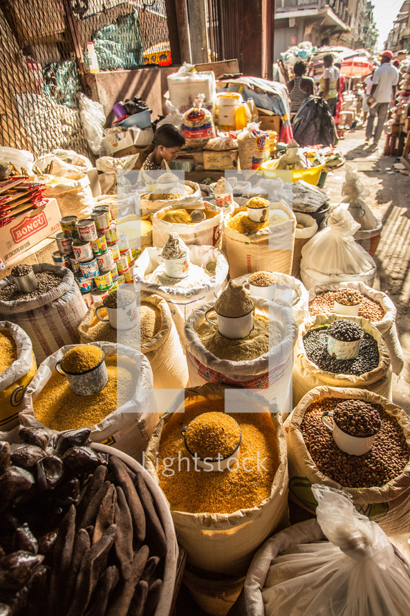 seeds, spices, grains, and herbs in baskets in a market in Haiti