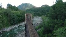 a train bridge over a river