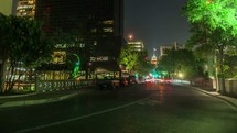 time-lapse of passing headlights from cars in a city at night