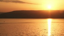 Closeup of sunrise over the Sea of Galilee.