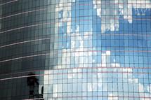 reflection in glass windows on a skyscraper