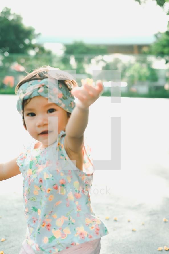 toddler girl handing you a leaf