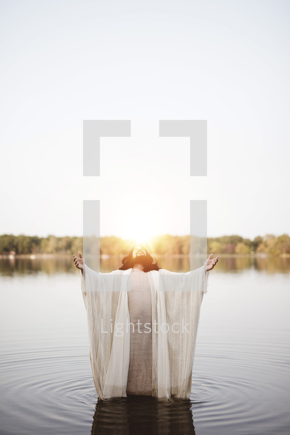 Jesus standing in water with outstretched arms