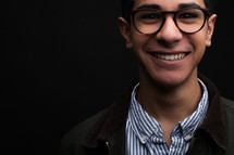 face of a young man in glasses