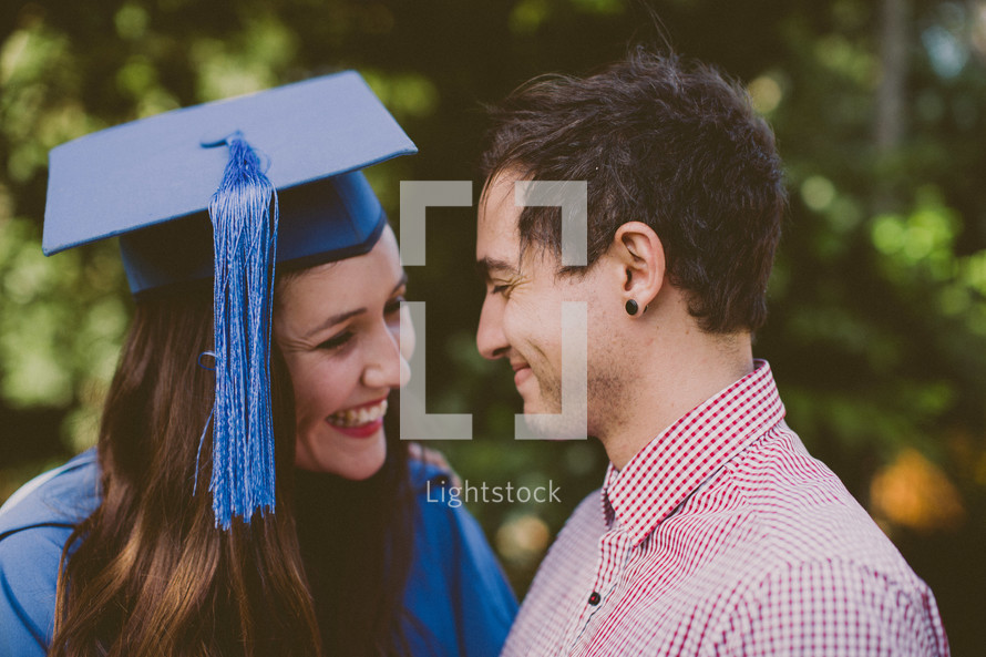 Smiling couple at graduation.