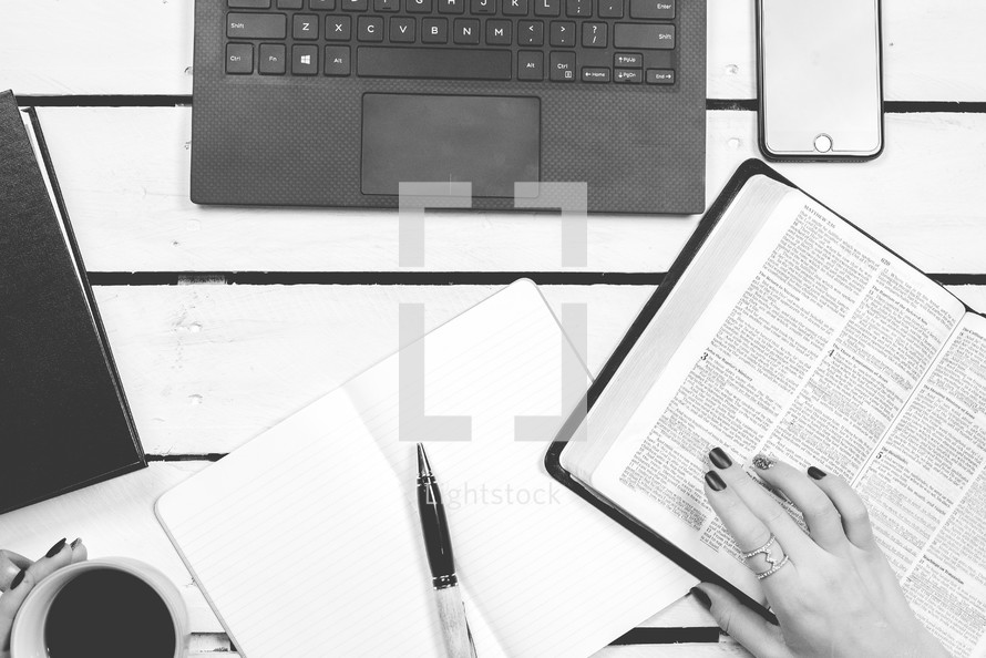 woman studying scripture at her desk