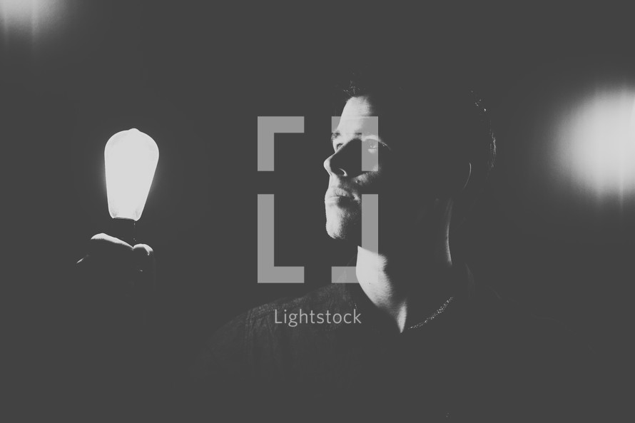 man holding a lightbulb