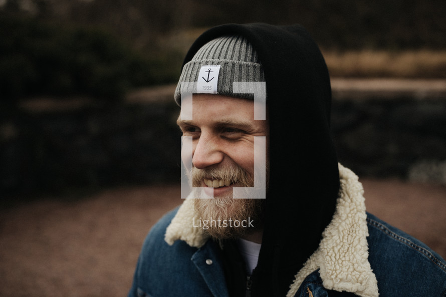 smiling bearded man in a beanie