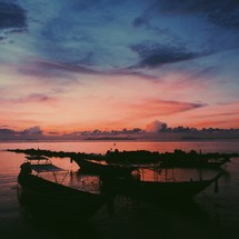 boats in the water at sunset