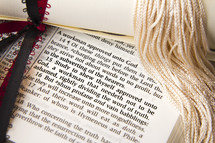diploma and tassel on the pages of a Bible
