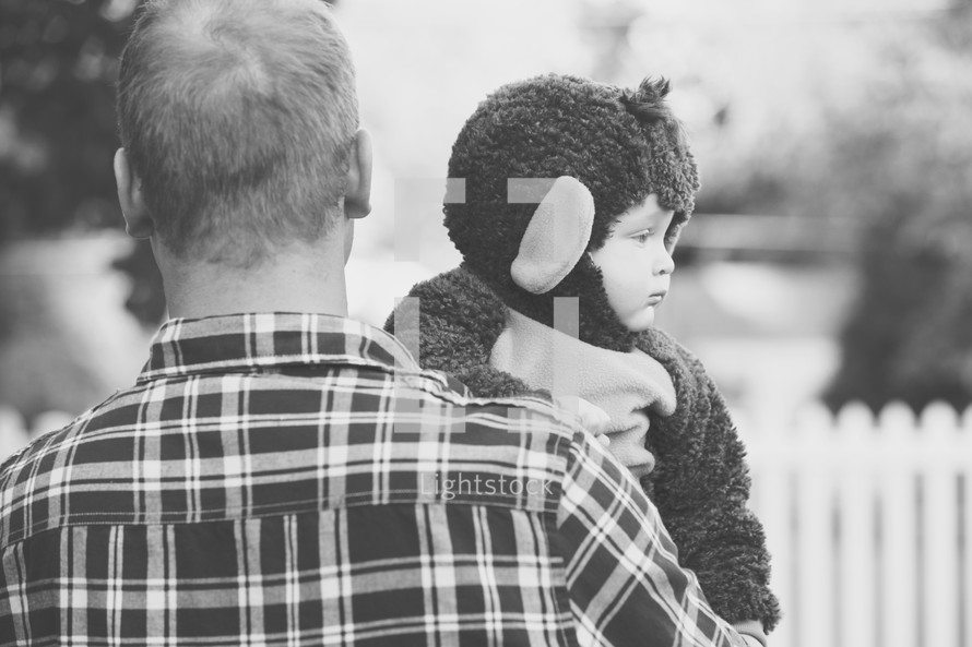man holding a child in a monkey costume