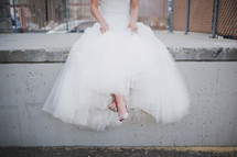 Bride sitting on a curb