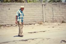 elderly man crossing the street