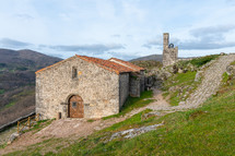 Church of San Juan Bautista and bulrush tower in Trevejo, Caceres, Extremadura, Spain