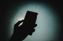 silhouette holding a phone