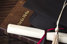 Spanish Bible, diploma, cap, tassel