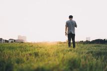 man standing in green grass