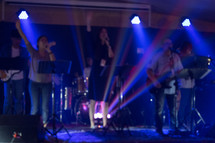 worship leaders on stage during a worship service