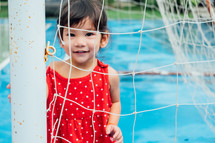 little girl standing in a net