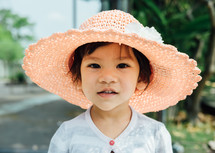little girl in a sunhat