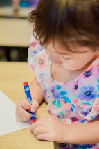toddler coloring with crayons