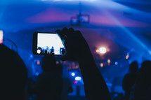 taking a picture of a concert with a cellphone