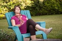 woman resting in a chair outdoors