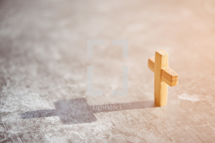 small wooden cross with shadow