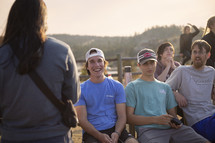 group of smiling young men outdoors