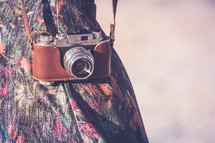 vintage camera in a case over a woman's arm