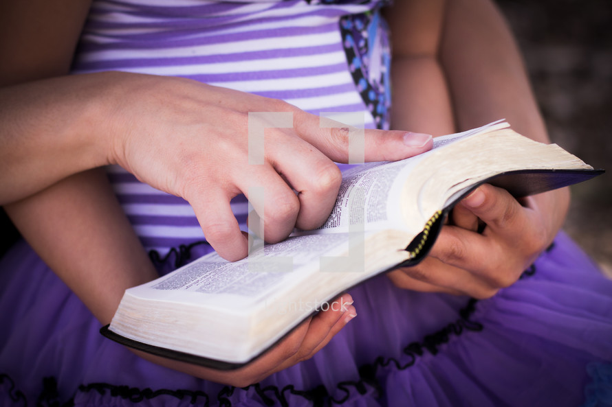 Mother and daughter reading the Bible.